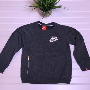 Nike 7/L sweatshirt with a front zipper